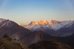 Halny szczyt podczas z zmierzchem na wierzchołku, Rakaposhi halny szczyt Zdjęcia Stock
