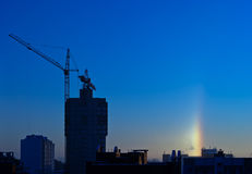 Halo over the city in the frosty winter morning Stock Photos