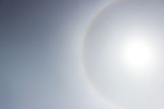 Halo a rainbow around the sun in the afternoon before the weather worsens. Stock Photos