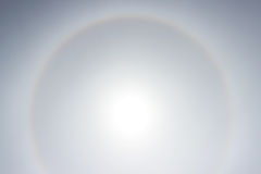 Halo a rainbow around the sun in the afternoon before the weather worsens. Stock Images
