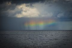 Halo / rainbow after a thunderstorm. Rainbow over the baltic sea after a thunderstorm Stock Photography