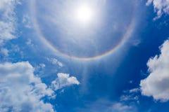 Halo sun. Blue cloudy sky with halo sun stock photo