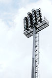 Halogen floodlight. Tower with cloudy background Stock Images