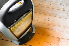 Halogen or infra heater. In action against wooden floor royalty free stock photos