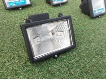 Halogen lamp on grass Stock Images
