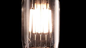Halogen lamp. Real light bulb flickering. Tungsten filament of electric bulb. Lo stock video footage