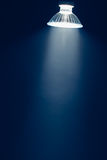 Halogen lamp with reflector, blue light in haze. Halogen lamp with reflector, blue beam light in haze, copy-space for your text royalty free stock photos
