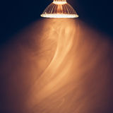 Halogen lamp with reflector, warm light in fog Stock Photography