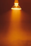 Halogen lamp with reflector, warm light in a fog Royalty Free Stock Photo