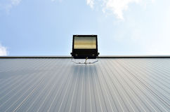 Halogen light on the warehouse wall Royalty Free Stock Photo