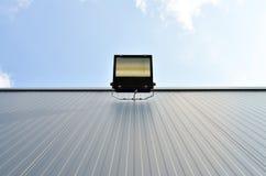 Halogen light on the warehouse wall Royalty Free Stock Photo