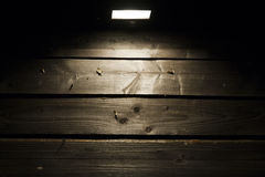 Halogen on wooden wall. Background with copy space - halogen lamp on wooden plank old wall stock photography
