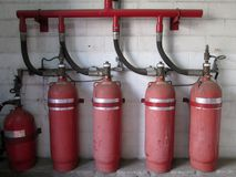 Halon 1301 cylinders. Fire extinguisher system. Halon is a gas fire extinguisher used before. Halogenated are chemicals that are able to extinguish the fire by Stock Images