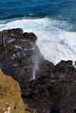 Halona Blowhole spraying water through its lava tube Stock Photography
