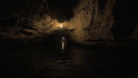 In Halong Bay in Hanoi, Vietnam seen river and dark grotto. In Halong Bay in Hanoi, Vietnam from first-person in boat seen river and dark grotto stock video footage