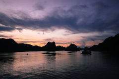 Halong Bay. A junk boat on Halong Bay, Vietnam at sunset Royalty Free Stock Photography