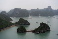 Halong Bay in mystical clouds. Mystical atmoshpere in the world famous halong bay. royalty free stock photo