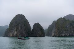 Halong Bay in mystical clouds. Mystical atmoshpere in the world famous halong bay. royalty free stock photography