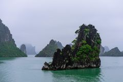 Halong Bay in mystical clouds. Mystical atmoshpere in the world famous halong bay. stock image