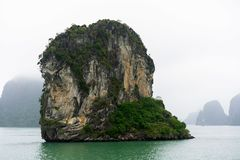 Halong Bay in mystical clouds. Mystical atmoshpere in the world famous halong bay. stock images