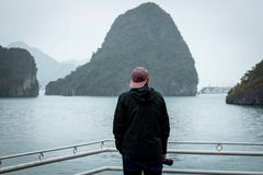 Halong Bay in mystical clouds. Mystical atmoshpere in the world famous halong bay. royalty free stock image