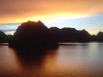 Halong bay sunrise. Sunrise on boat in halong bay Royalty Free Stock Images