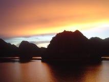 Halong bay sunrise. Sunrise on boat in halong bay Royalty Free Stock Photography