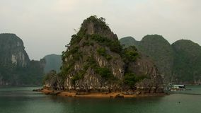 Halong bay before sunset with floating houses and boats stock video