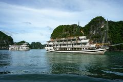 Halong bay with tourist junks and rocky islands. Popular landmark, famous destination of Vietnam.  stock photography