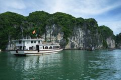 Halong bay with tourist junks and rocky islands. Popular landmark, famous destination of Vietnam.  stock photos