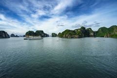 Halong bay with tourist junks and rocky islands. Popular landmark, famous destination of Vietnam.  royalty free stock images