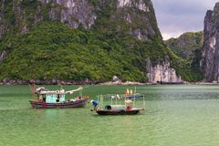 Halong bay traditional fishing boats, UNESCO world natural heritage, Vietnam. Halong bay with two Vietnamese traditional fishing boats, UNESCO world natural royalty free stock photos