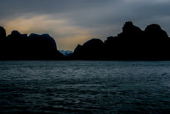 Halong Bay at twilight. Picturesque cliffs of Halong Bay in the gathering dusk Royalty Free Stock Images