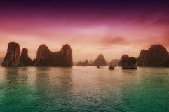 Halong Bay Vietnam. The dramatic landscape of HaLong Bay in northern vietnam as boats move through it stock photography