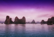 Halong Bay Vietnam. The dramatic landscape of HaLong Bay in northern vietnam as boats move through it stock images