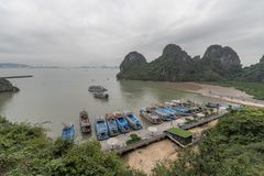 Halong bay,Vietnam:March 29 2019 - Tourist travel by ship to Halong bay limestone islands in northest vietnam for playing bamboo stock photos