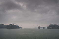 Halong Bay Vietnam in the mist Stock Photo