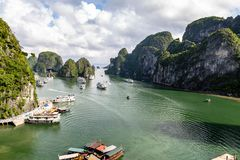 Halong Bay, Vietnam -panorama of the bay in front of Hang Sung Sot grottoes. Halong Bay is a UNESCO World Heritage Site, famous for its karst formations royalty free stock images