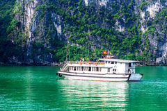 HALONG BAY, VIETNAM - SEPTEMBER 24, 2014 - Tourist ship cruising inside the Bay. Royalty Free Stock Images