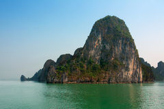 Halong Bay Vietnam with tourist boats and hazy blue sky Stock Image