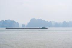 Halong bay view, Vietnam. Halong bay view with cargo ship, Vietnam Royalty Free Stock Image