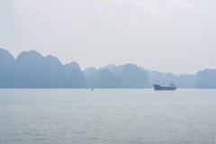 Halong bay view, Vietnam. Halong bay with cargo ship view, Vietnam Royalty Free Stock Image