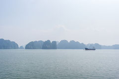 Halong bay view, Vietnam. Halong bay with cargo ship view, Vietnam Stock Images