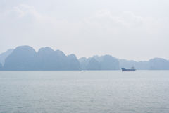 Halong bay view, Vietnam. Halong bay with cargo ship view, Vietnam Stock Photography