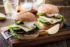 Haloumi burger with grilled vegetables and romaine lettuce. Rustic on wooden table Stock Photography
