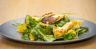 Haloumi salad. With rocket, spinach and orange Stock Images