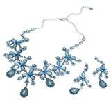 Halsband en oorringen met blauwe gemmen Stock Afbeeldingen