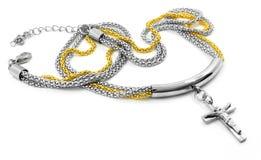Halsband för kvinnor med ett kors arkivbilder