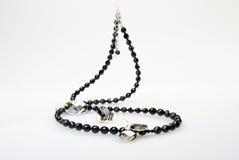 Halsband, hangend, ring en oorringen Stock Foto