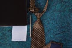 Halsdoek en notitieboekje stock foto's